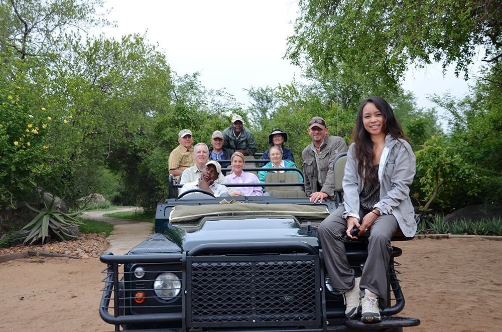 A group of people in a Land Rover on safari in Londolozi Game Reserve, South Africa.