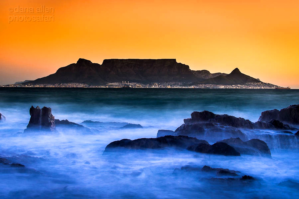 Table Mountain covered in mist at sunrise. South Africa.