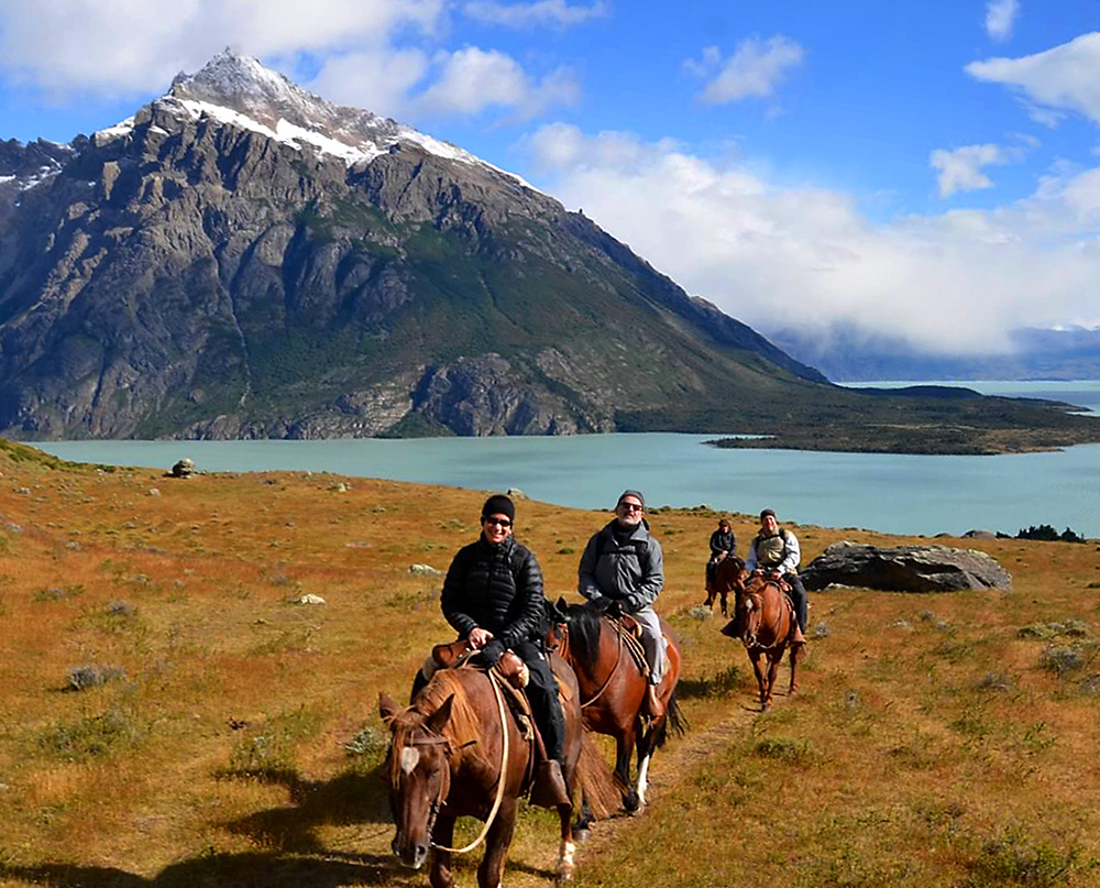 Horseback riding in Patagonia near Hostería Helsingfors, a windswept-but-beautiful locale on Lago Viedma.