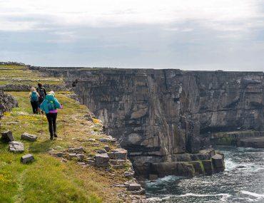 ireland-west-coast-hiker-near-sea-cliff